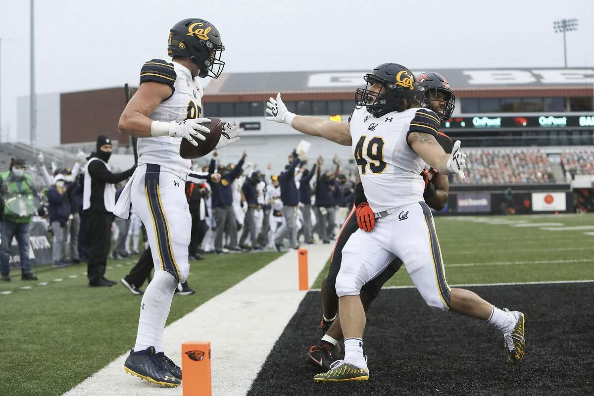 Cal's Drew Schlegel (right), a grad transfer, greets teammate Jake Tonges after a touchdown.