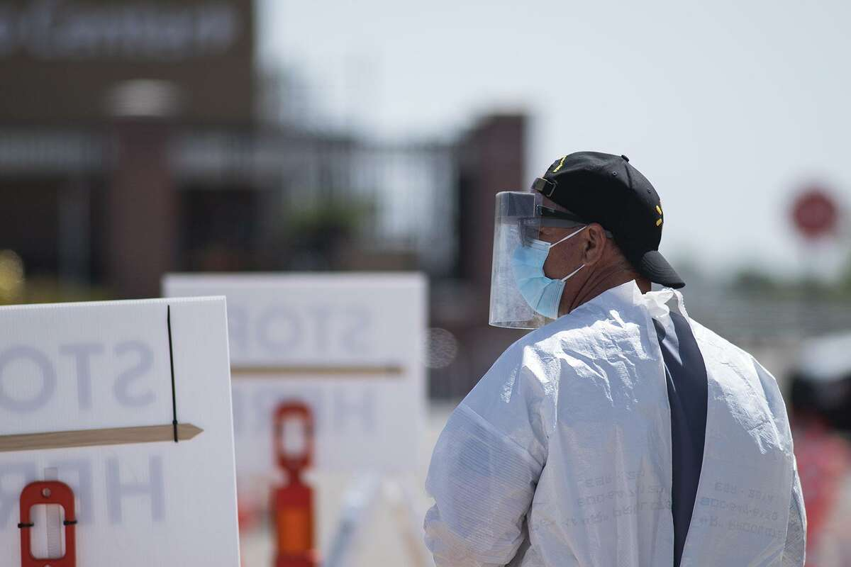 A tester waits for patients at a COVID-19 drive through testing site in the Walmart parking lot near the corner of 114th Street and Quaker Avenue on Friday, April 24, 2020, in Lubbock, Texas. (Justin Rex/Austin American-Statesman/TNS)