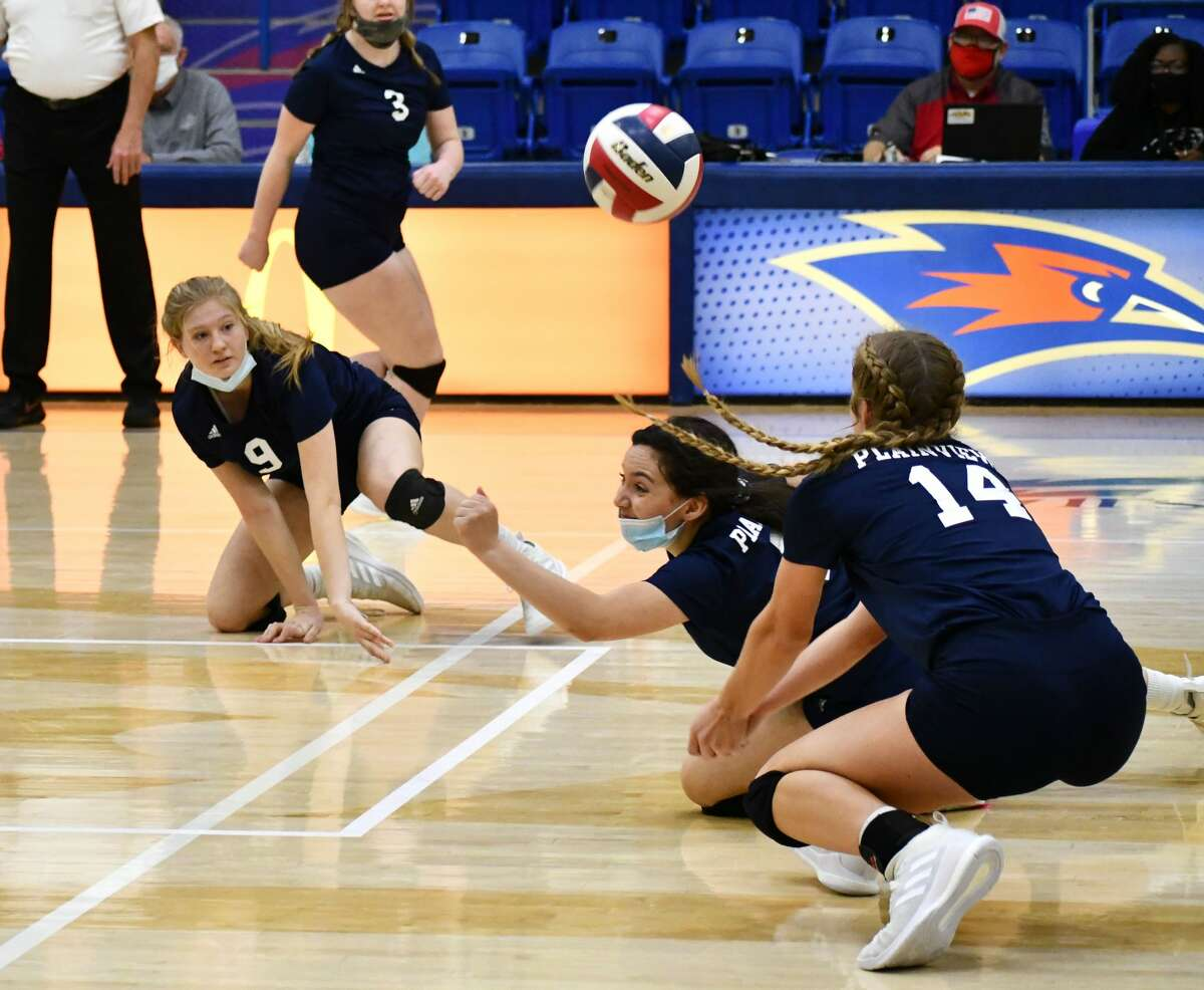 Plainview players Haley Alderete (middle), Haley Curtis (9) and Saige Brunson try to keep the ball alive during their Class 5A bi-district volleyball match against Lubbock-Cooper on Nov. 21, 2020 in the Rip Griffin Center at Lubbock Christian University in Lubbock.