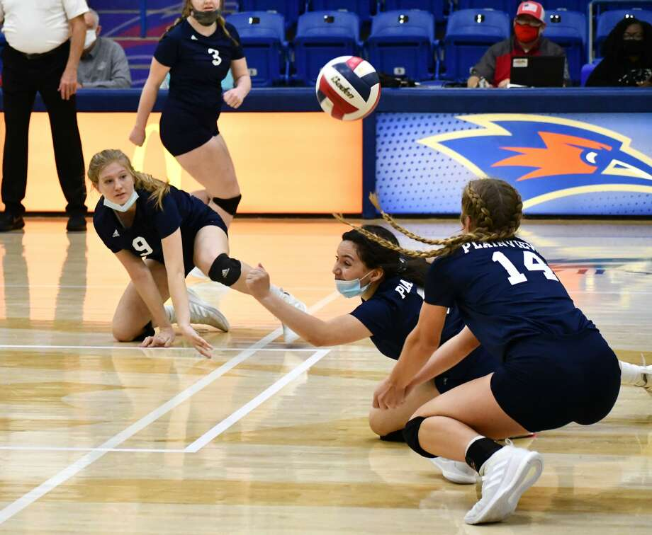 Plainview players Haley Alderete (middle), Haley Curtis (9) and Saige Brunson try to keep the ball alive during their Class 5A bi-district volleyball match against Lubbock-Cooper on Nov. 21, 2020 in the Rip Griffin Center at Lubbock Christian University in Lubbock. Photo: Nathan Giese/Planview Herald