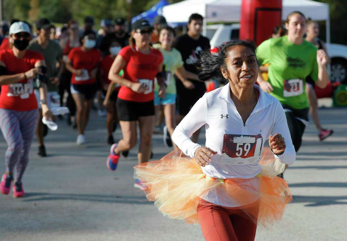 More than 200 runners took part in Conroe's annual Turkey Trot .