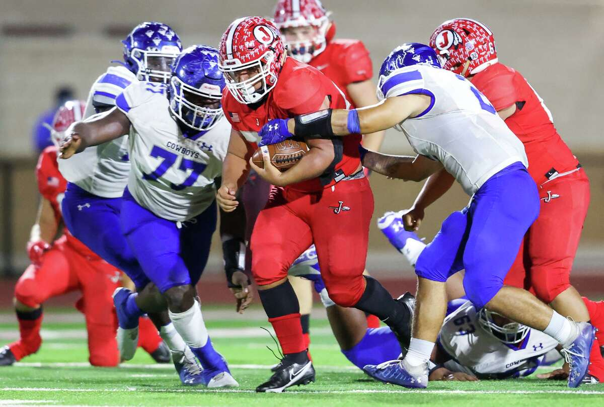 Jourdanton running back Juan Lerma, center, runs through the Edna defense for a first down during the second half of their second round Class 3A-1 high school football game at Indian Stadium in Jourdanton on Saturday, Nov. 21, 2020. Jourdanton beat Edna 42-28.