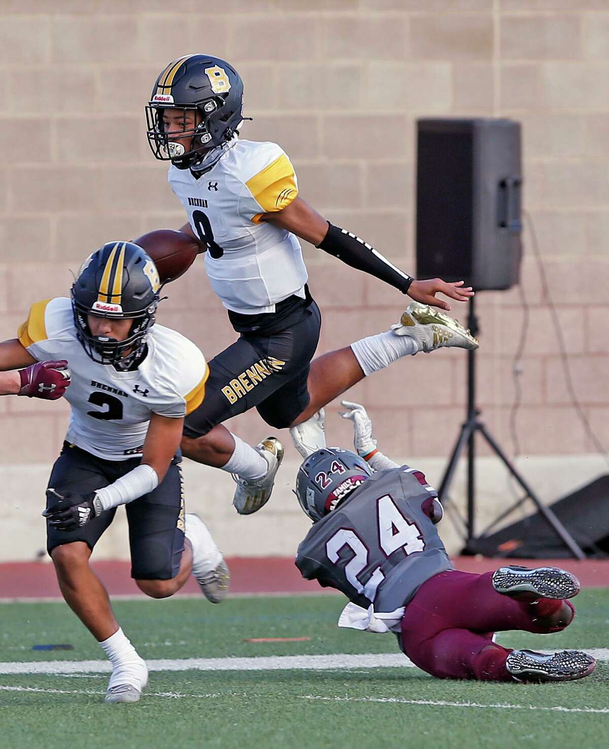 Brennan QB Ashton Dubose leaps over Marshall DB Kimarion Todd. Brennan vs Marshall on Saturday, Nov. 21, 2020 at Farris Stadium.