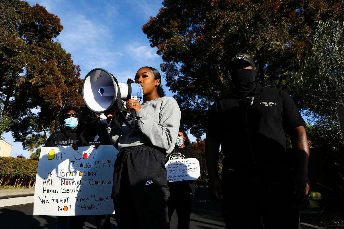 Jariell Jones speaks during a racial justice march that stopped in front of the Discovery Bay Country Club.