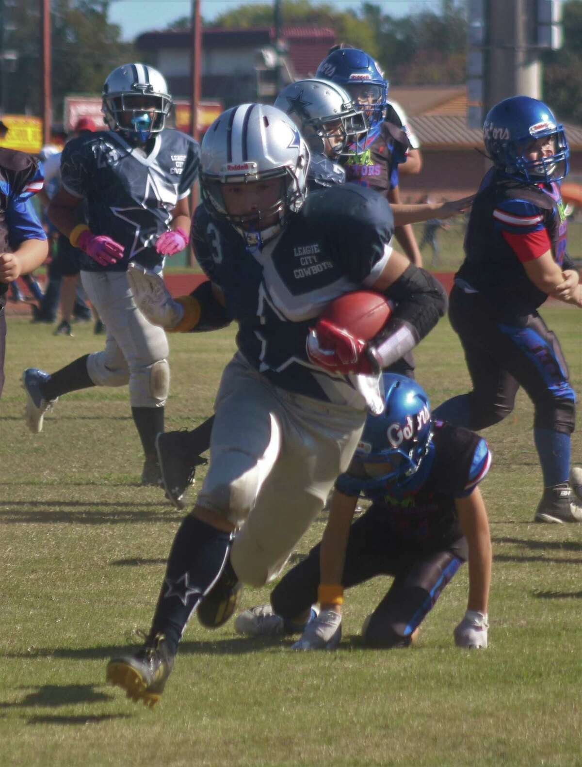 League City Senior Cowboy running back Michael Pugh, Jr., motors for some of the 200 yards he chewed up Saturday afternoon. He scored twice in the 25-18 loss.