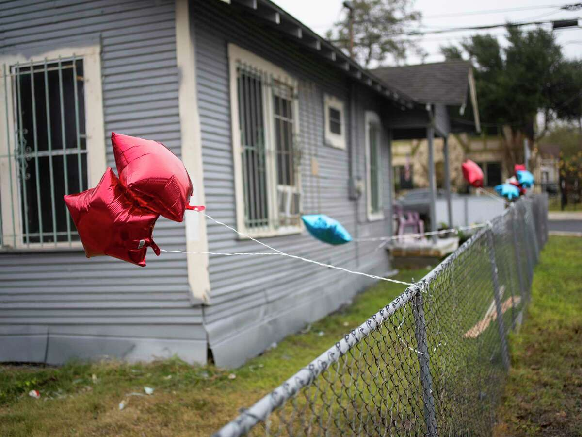 Balloons hang on the fence of Gilberto and Alicia Aleman's home in the Harvard Place-Eastlawn Neighborhood of San Antonio on Saturday, November 21, 2020. Neighborhoods First Alliance sponsored an Eastside Paint-A-Thon on Saturday, with volunteers painting the home of Gilberto and Alicia Aleman as part of the nonprofit's