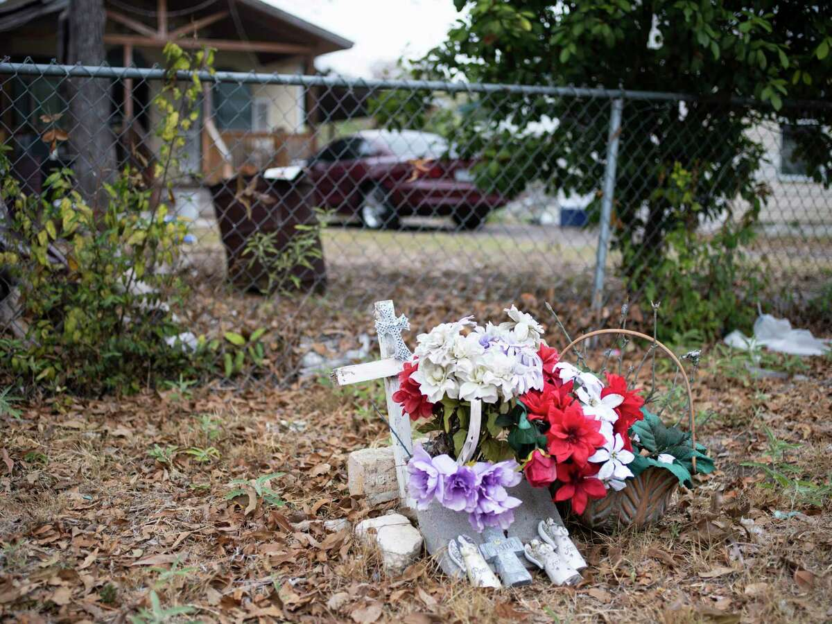 A memorial for Destiny Garcia, a 26-year-old who was shot to death in the Harvard Place-Eastlawn neighborhood of San Antonio in 2016, rests on Hays Street on Saturday, November 21, 2020. Neighborhoods First Alliance sponsored an Eastside Paint-A-Thon on Saturday, including painting the home of Gilberto and Alicia Aleman on Hays Street as part of the nonprofit's