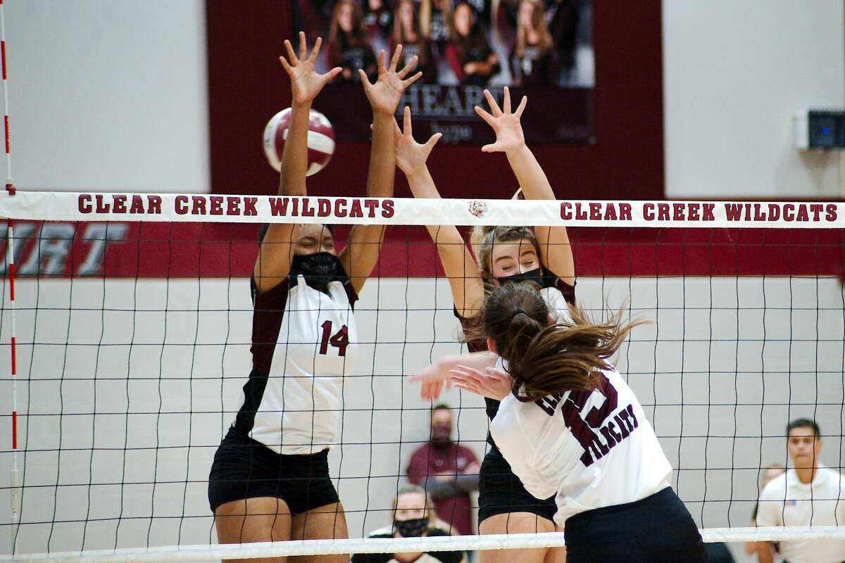 Pearland's Aryelle Stevens (14) and Pearland's Avery Schwartz (18) try to block a shot by Clear Creek's Brooke Morgan (15) Saturday, Nov. 21 at Clear Creek High School.
