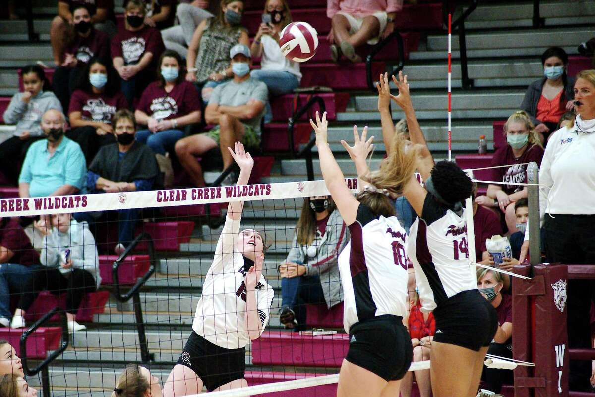 Clear Creek's Brooke Morgan (15) tries to hit a shot past Pearland's Madie Whitehead (10) and Aryelle Stevens (14) Saturday, Nov. 21 at Clear Creek High School.