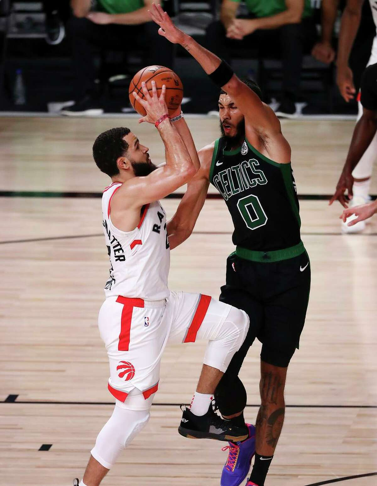 The Raptors' Fred VanVleet shoots over Jayson Tatum of the Celtics in the 2020 playoffs. VanVleet is staying with Toronto.