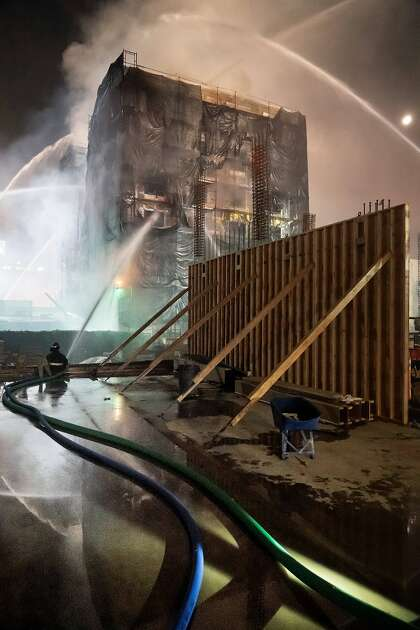 Firefighters put out six alarm fires at a Berkeley building under construction on University Ave.  Saturday, November 21, 2020 in Berkeley, California.