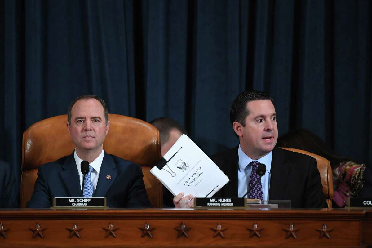 (L-r) Reps. Adam Schiff, D-Calif., and Devin Nunes, R-Calif., the House Intelligence Committee's top Democrat and Republican, respectively, oversee witness testimony during an impeachment inquiry hearing on Nov. 21, 2019.