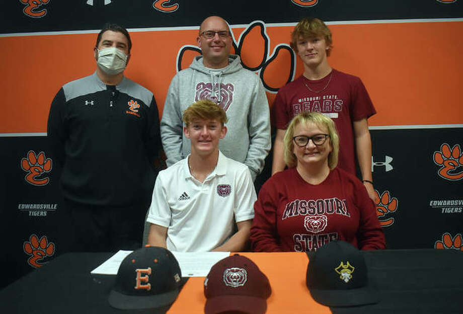 Edwardsville senior Hayden Moore, seated left, will play college baseball for Missouri State. He is joined in the picture by his family and EHS coach Tim Funkhouser. Photo: Matt Kamp|The Intelligencer