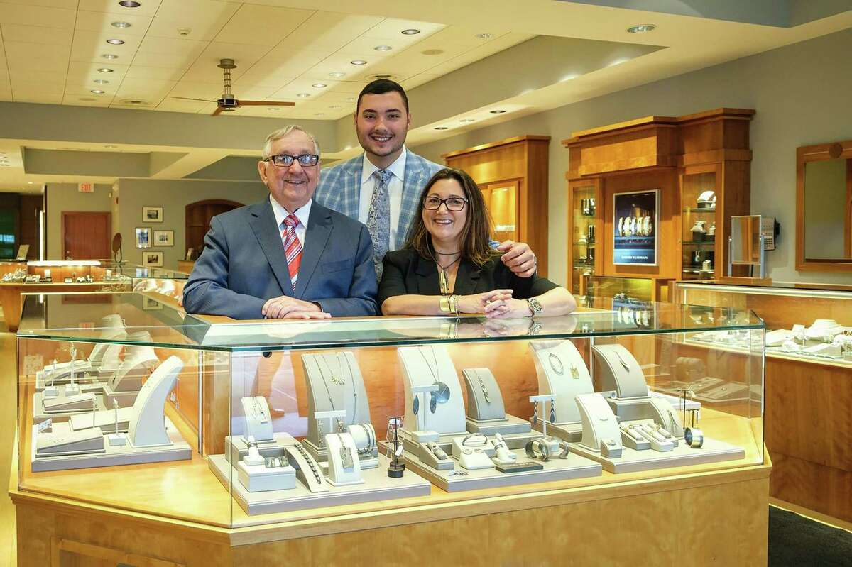 Kimberly Adams Russell with her father, David Adams, and son, Jeffrey Adams Russell at Frank Adams Jewelers.