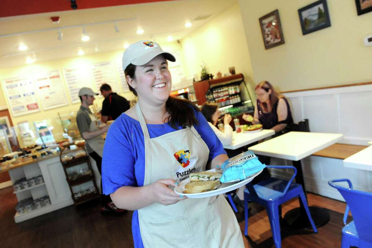 Owner Sara Mae Pratt (then Hickey) serves lunch in June of 2015 at Puzzles Bakery and Cafe in Schenectady.