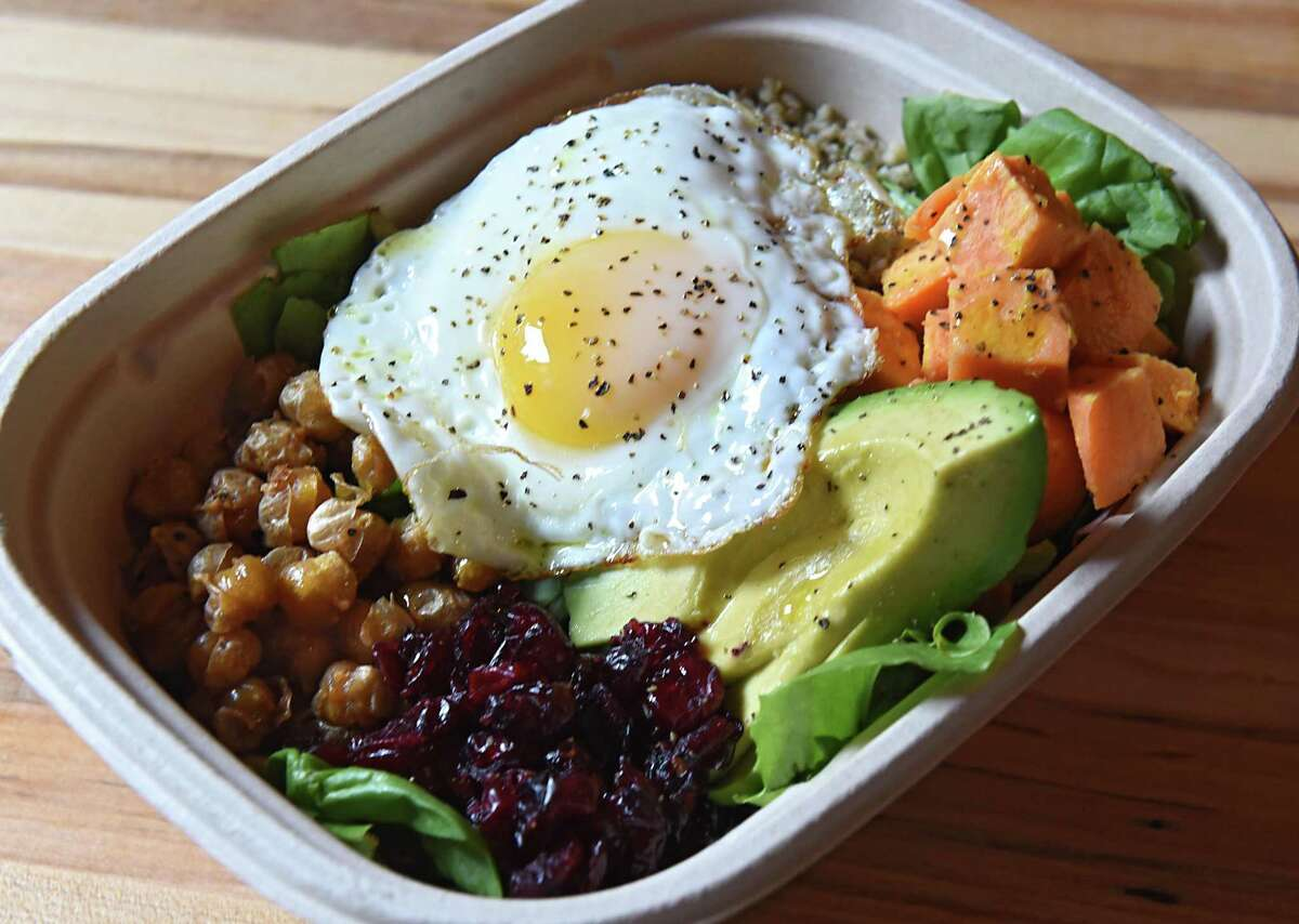 Dragon bowl with coconut quinoa, roasted sweet potatoes, fried cumin chickpeas, fried egg, Thai peanut dressing, avocado and toasted coconut at Farmers Hardware restaurant on Wednesday, July 26, 2017 in Saratoga Springs, N.Y. (Lori Van Buren / Times Union)