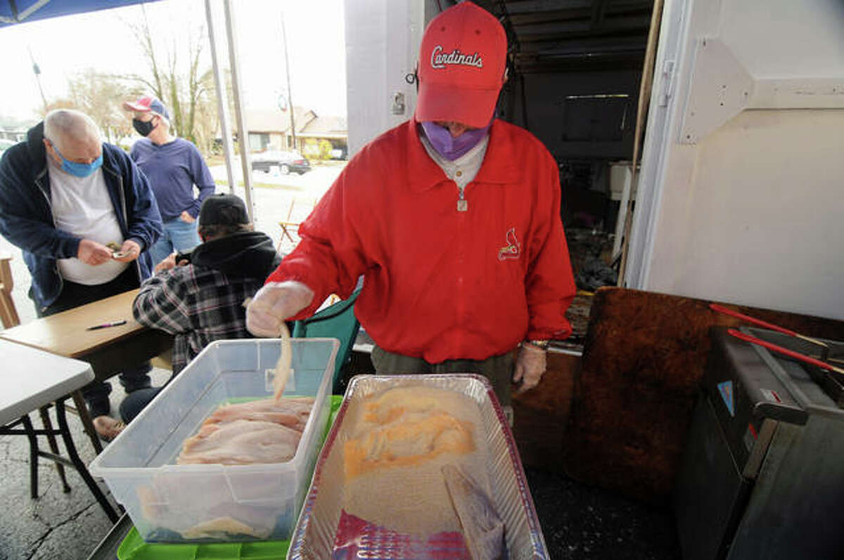 Bethalto Masonic Lodge Fish Fry event organizer Don Huber breads fish fillets on Saturday. As the lodge membership has declined, the monthly fish fries - held the third Saturday each month, almost always as sell-outs - are helping to cover the longtime lodge's costs.