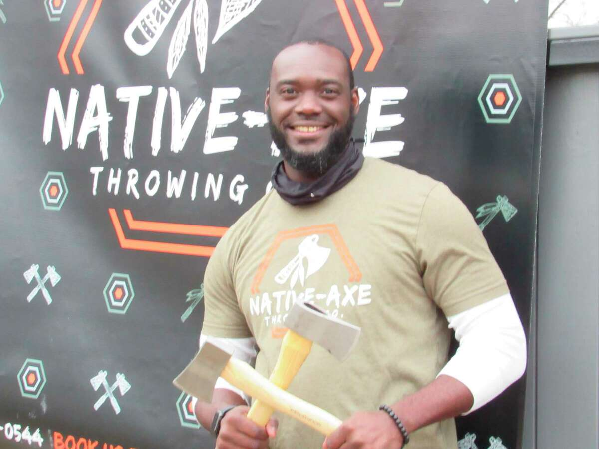 Ayo Akindona of Midland recently opened his business, Native-Axe Throwing Co. The mobile entertainment venue was most recently stationed in the parking lot of Live Oak Coffeehouse in Midland on Friday, Nov. 13. (Victoria Ritter/vritter@mdn.net)