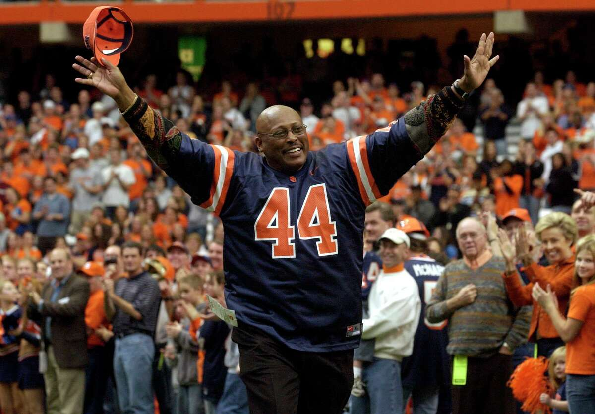 Former Syracuse and Denver Broncos running back Floyd Little acknowledges the crowd during a halftime ceremony to retire the No. 44 jersey in Syracuse, N.Y., Saturday, Nov. 12, 2005. (AP Photo/Kevin Rivoli)