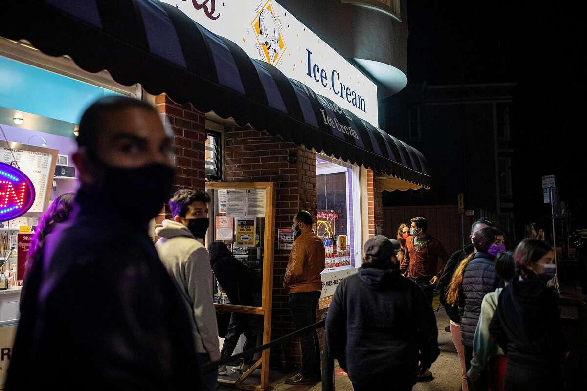 People line up to buy from Mitchell's Ice Cream, Friday, Nov. 20, 2020, in San Francisco.