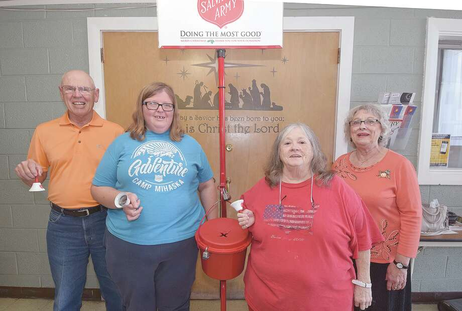 Long-time Salvation Army Red Kettle campaign bell-ringers Bob Nicolet (from left), Laura Wigger, Joyce Bock and Sonie Smith. Photo: David Blanchette   Journal-Courier