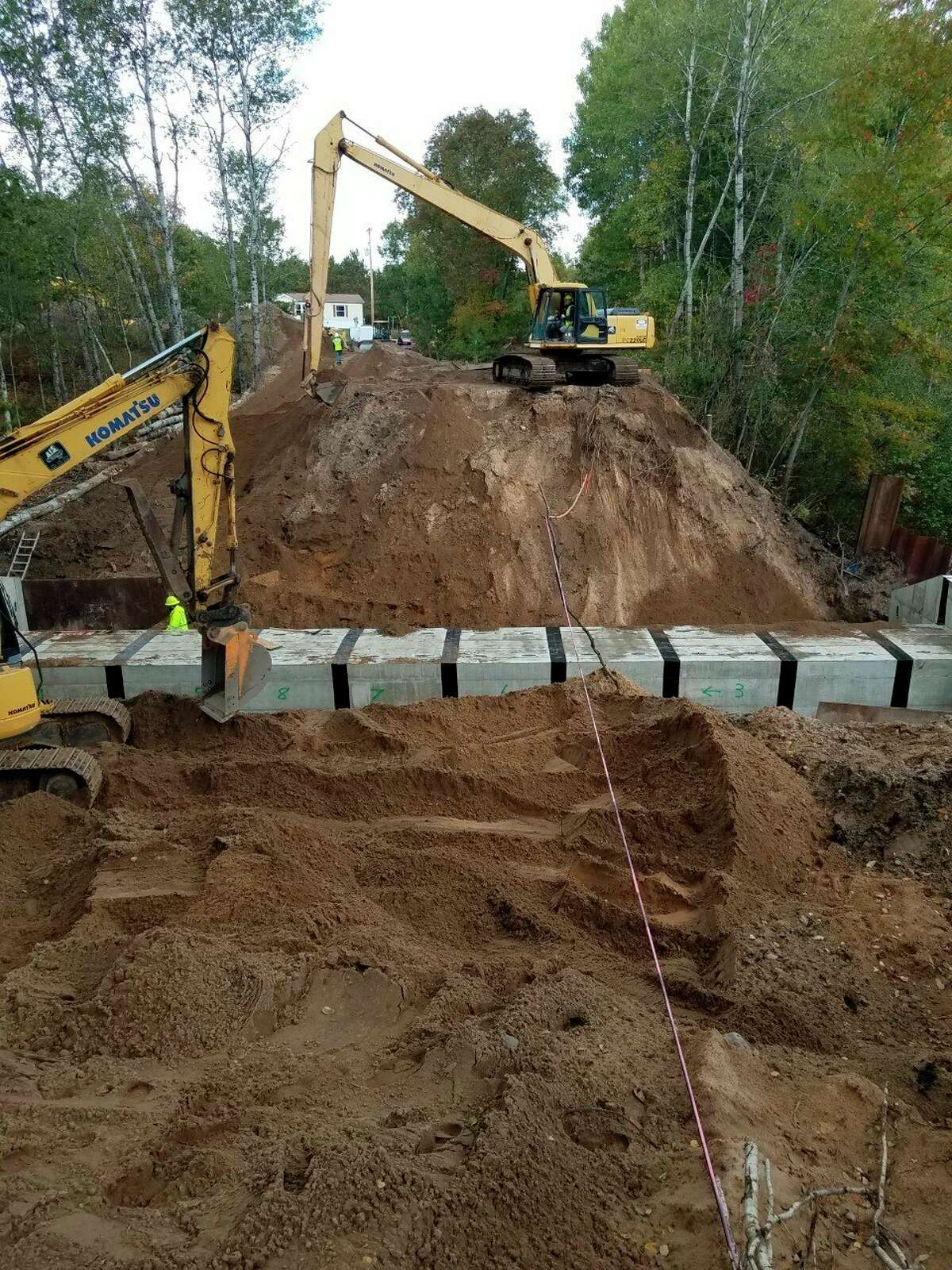 Pictured is the replacement of a collapsed culvert on the White Pine Trail this summer, six miles south of Big Rapids. Two more are planned for replacement next summer. (Courtesy photo)