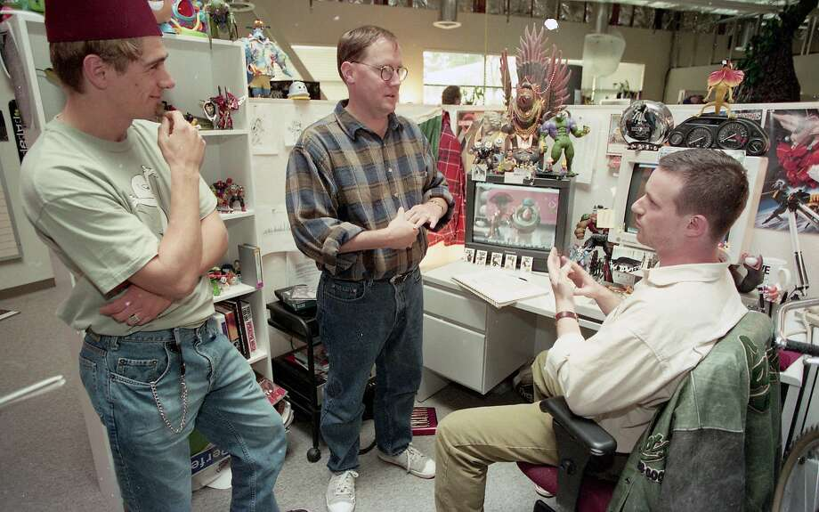 """Nov. 2, 1995: """"Toy Story"""" director John Lasseter (center) makes the rounds at Pixar's office park space in Point Richmond. Photo: Jerry Telfer / The Chronicle"""