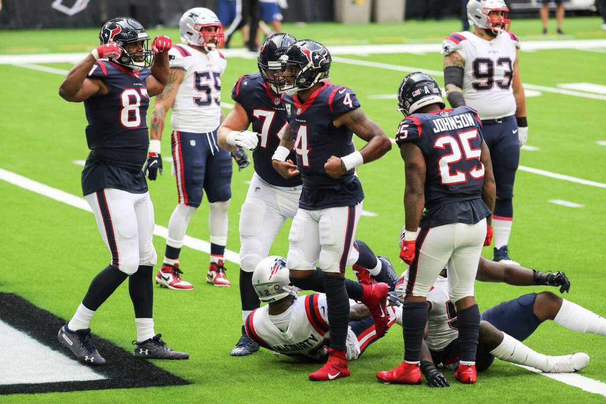 Houston Texans quarterback Deshaun Watson (4) celebrates his 4-yard touchdown run against the New England Patriots during the first half of an NFL football game at NRG Stadium on Sunday, Nov. 22, 2020, in Houston.
