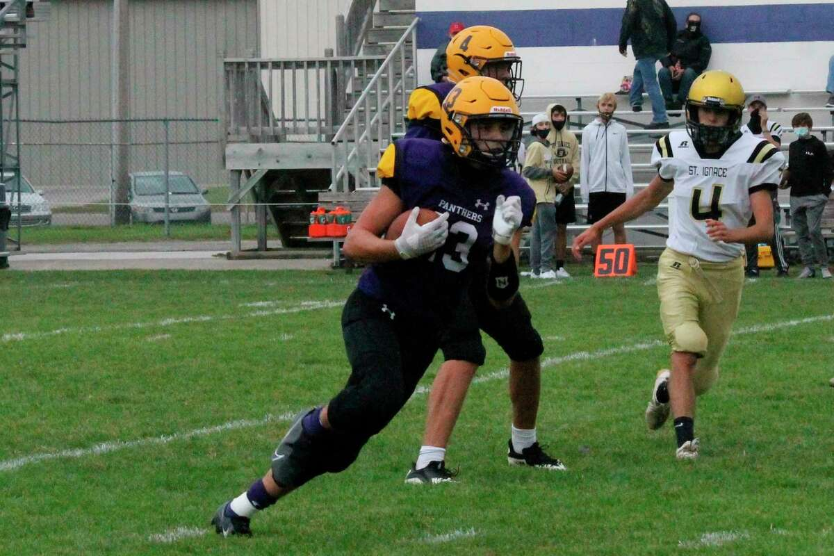 Junior running back Adam Mills carries the ball for the Panthers during a win over St. Ignace on Sept. 26 (File photo)