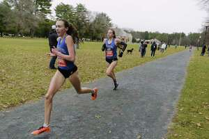 Mackenzie Hart of Saratoga Springs High School, left, and her teammate, Sheridan Wheeler run towards the finish line during the Suburban Council cross country championships on Sunday, Nov. 22, 2020, at SPA State Park in Saratoga Springs, N.Y. Hart finished second overall and Wheeler finished third overall.  (Paul Buckowski/Times Union)