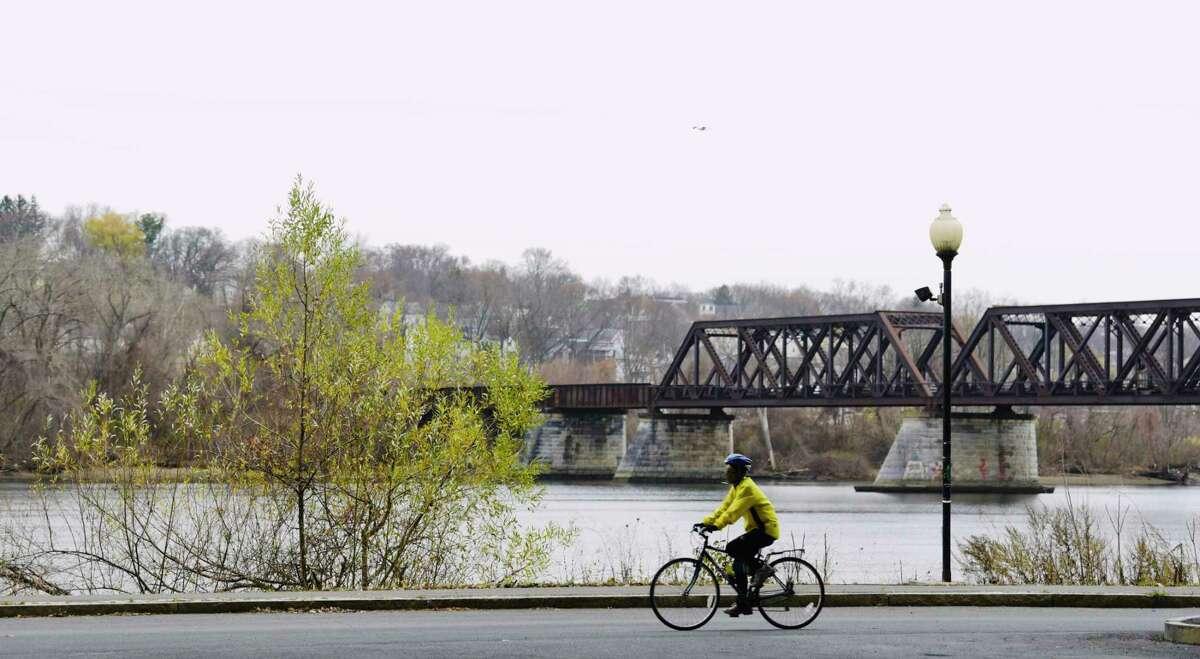 A bicyclist rides along the Hudson River on Sunday, Nov. 22, 2020, in Albany, N.Y. (Paul Buckowski/Times Union)