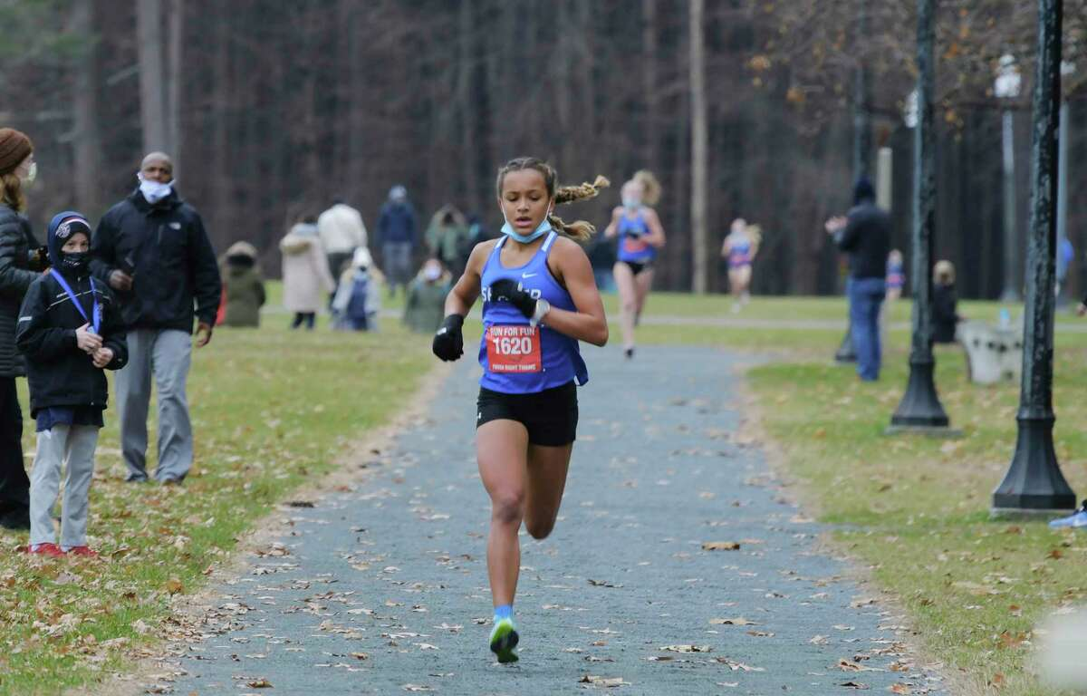 Leonni Griffin of Shaker High School runs towards the finish line during the Suburban Council cross country championships on Sunday, Nov. 22, 2020, at SPA State Park in Saratoga Springs, N.Y. (Paul Buckowski/Times Union)
