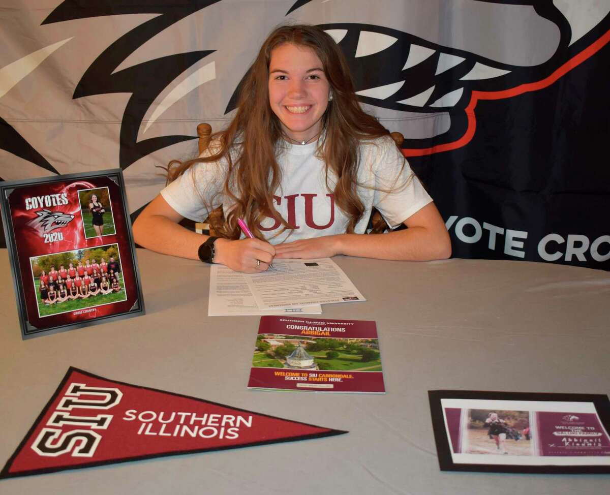 Reed City's Abbigail Kiaunis signs her letter of intent last week to run at Southern Illinois University. (Courtesy photo)