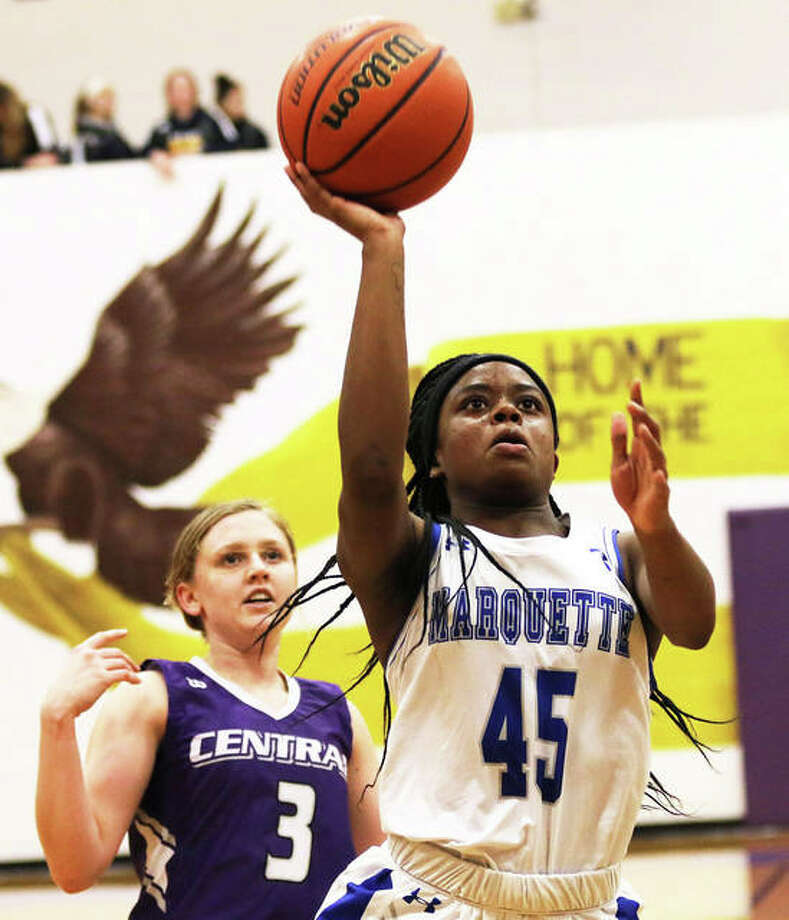 Marquette Catholic's Adrenna Snipes (45) beats a Breese Central defender to the basket on a fast break at the CM Shootout on Dec. 20 in Bethalto. Snipes, who scored more than 1,000 points in two seasons with the Explorers, has transferred to Alton High for her junior season.