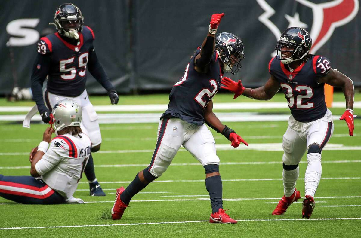 Texans defensive backs Lonnie Johnson (32) and Justin Reid (20) brought the pressure on Patriots QB Cam Newton with the game on the line Sunday.