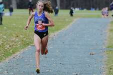 Ella Kurto of Saratoga Springs High School runs towards the finish line during the Suburban Council cross country championships on Sunday, Nov. 22, 2020, at SPA State Park in Saratoga Springs, N.Y. Kurto took first place in the championship. (Paul Buckowski/Times Union)