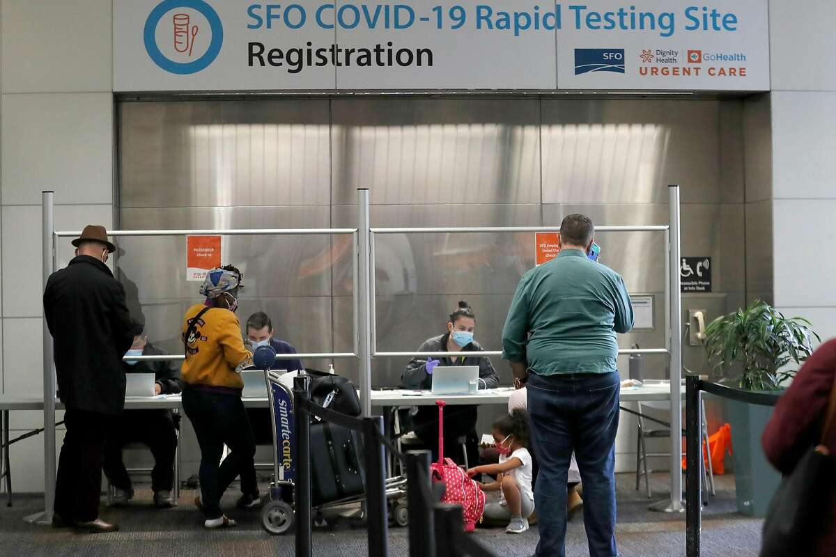 Travelers are tested for the coronavirus at San Francisco International Airport in November.