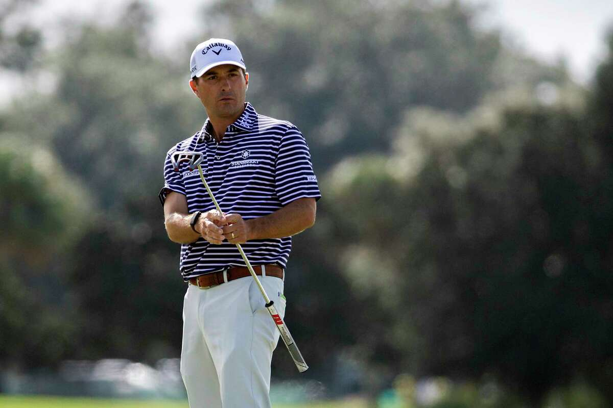 Kevin Kisner reacts to a missed birdie putt on the first green during the final round of the RSM Classic golf tournament, Sunday, in St. Simons Island, Ga. (AP Photo/Stephen B. Morton)