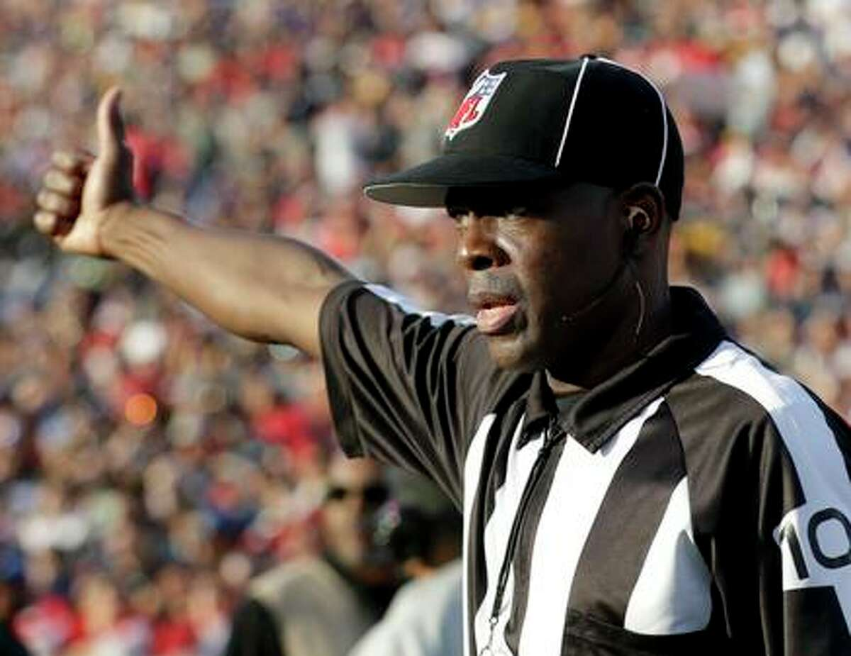 Official, field judge Dale Shaw gestures during the first half in an NFL football game between the Los Angeles Rams and the San Francisco 49ers Sunday, Dec. 30, 2018, in Los Angeles.