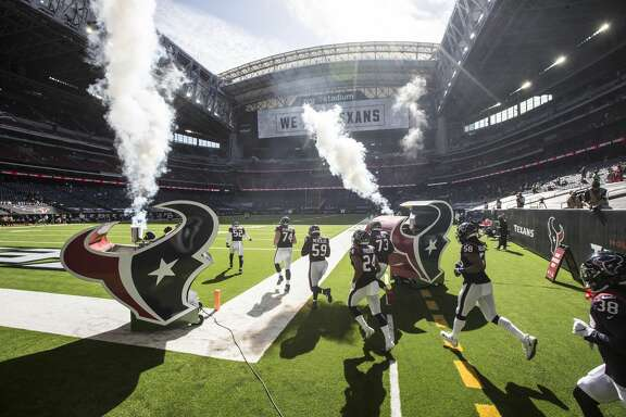The Houston Texans run onto the field for the during the first half of an NFL football game against the New England Patriots at NRG Stadium on Sunday, Nov. 22, 2020, in Houston.