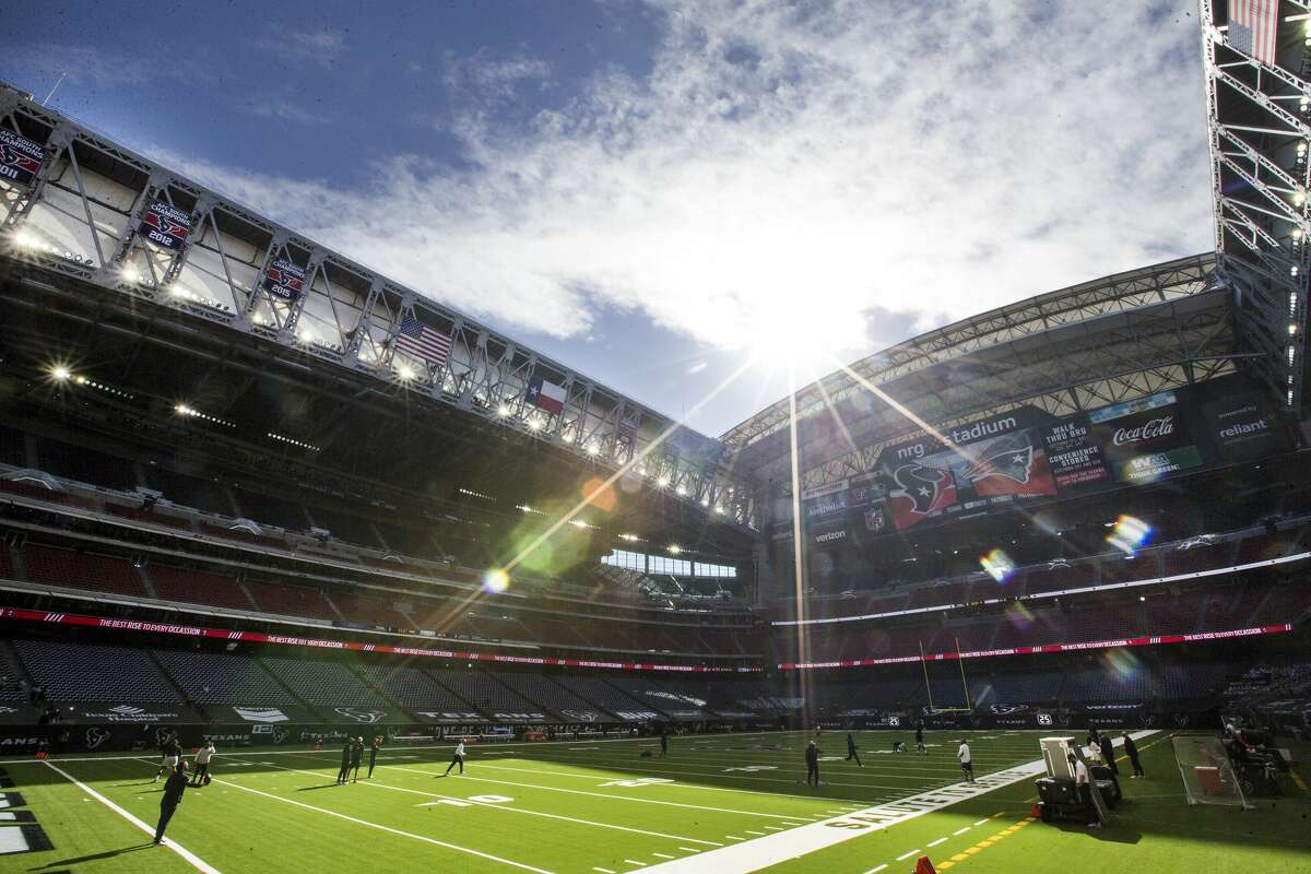 The Houston Texans and New England Patriots warm up under an open roof before an NFL football game at NRG Stadium on Sunday, Nov. 22, 2020, in Houston. Sunday marked the first time since 2014 that the roof was opened for a Texans game.
