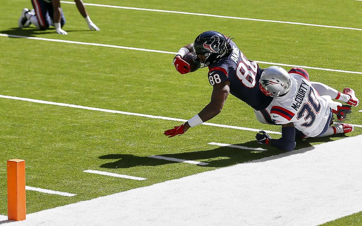 Houston Texans tight end Jordan Akins (88) is tackled by New England Patriots cornerback Jason McCourty (30) during the first quarter of an NFL game Sunday, Nov. 22, 2020, at NRG Stadium in Houston.