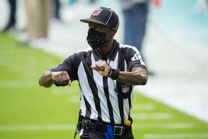 Down Judge Julian Mapp (10) gestures as the Buffalo Bills take on the Miami Dolphins during an NFL football game, Sunday, Sept. 20, 2020, in Miami Gardens, Fla.
