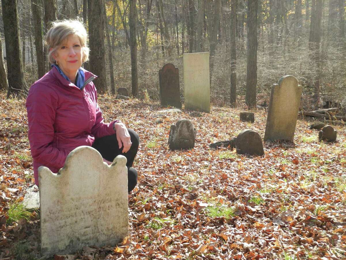 Debbie Garber of Wilton visits the grave of her ancestor, Samuel Middlebrook, a patriot of the American Revolution, who is buried in Comstock Cemetery.