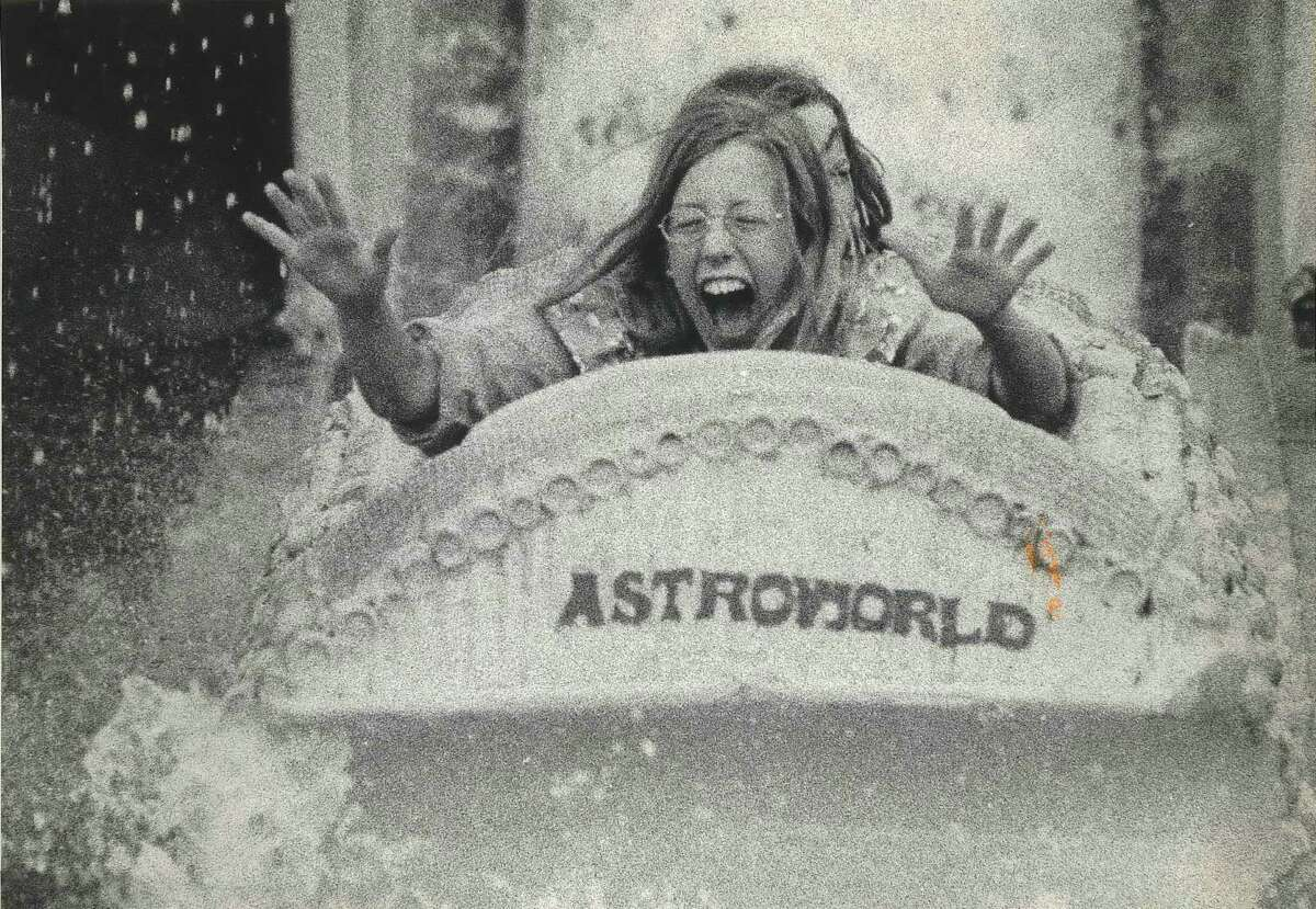 The face of a young rider, mirrors the excitement of a watery ride on the opening day of the summer season at Astroworld amusement park Friday. Bamboo Shoot Ride, Astroworld, Houston, Texas