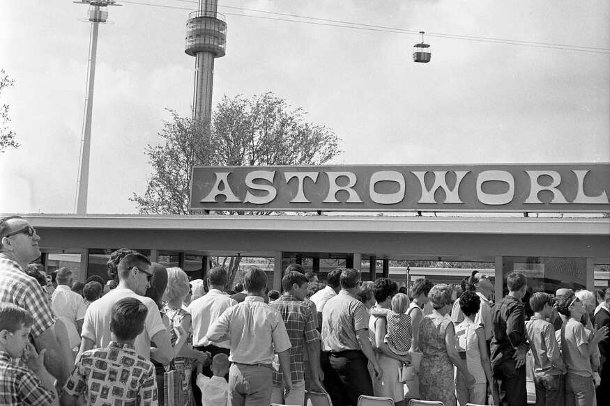 06/01/1968 - Opening day visitors queue up to push through the gates at Astroworld, the new 57-acre amusement park in the Astrodomain complex in Houston. Among the attractions seen waiting for them are the Astroneedle, a ride up a 340-foot golden needle, and the Astroway, a skyride that crosses the park.