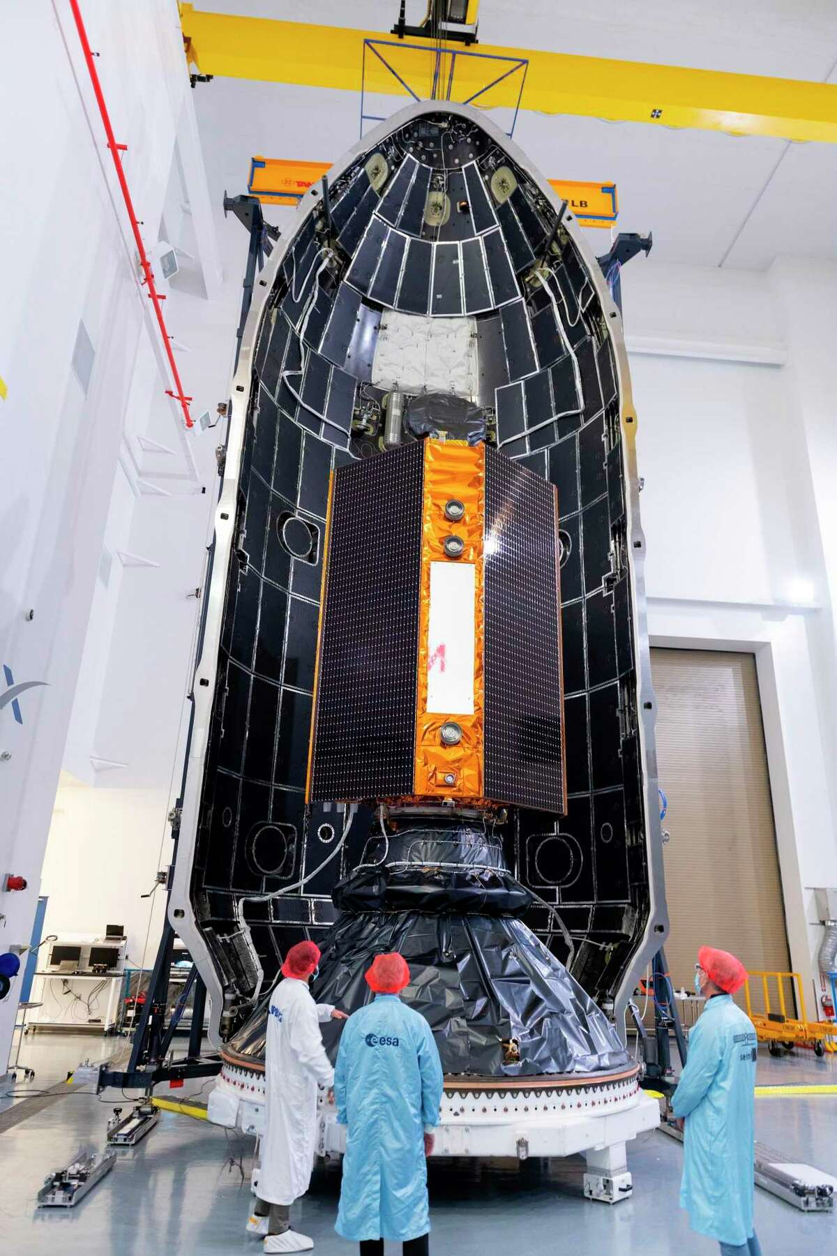 In this Nov. 3, 2020 photo, provided by the European Space Agency, the Sentinel-6 Michael Freilich satellite is placed inside the upper stage of a Falcon 9 rocket. The joint European-U.S. satellite mission to improve measurements of sea level rise was launched from Vandenberg Air Force Base in California on Saturday Nov. 21, 2020. The Sentinel-6 Michael Freilich satellite, named after the late director of NASA's Earth Science Division, is seen as a crucial tool for monitoring the impact of global warming on coastlines, where billions of people face the risk of encroaching oceans in the coming decades. (ESA/Stephane Corvaja via AP)