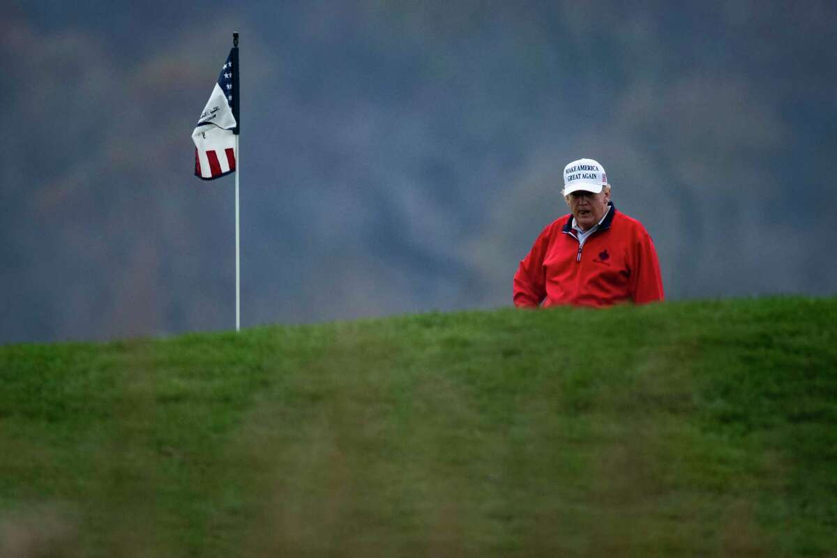 President Donald Trump plays a round of golf at the Trump National Golf Course in Sterling, Va., on Saturday, Nov 21, 2020.