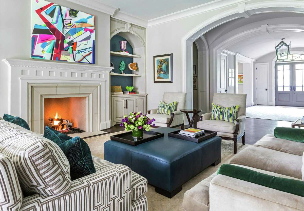 Classic designs from Barbara Barry's collections for Baker and Holly Hunt find a home in this family room. It is included in the new book,