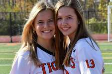 In their final game together, sisters Riley (left) and Mackenzie Peters scored goals to help the Ridgefield field hockey team win its first postseason title.